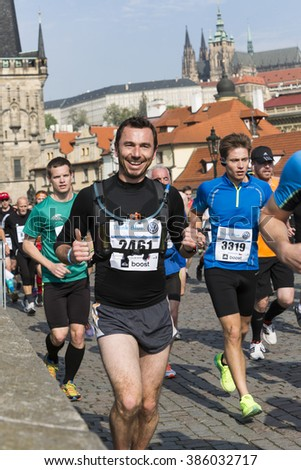 PRAGUE, CZECH REPUBLIC - 3 MAY 2015: A group of runners on the Charles Bridge in Prague Marathon. - stock photo