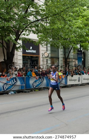 PRAGUE, CZECH REPUBLIC - MAY 3, 2015: African female runner finishing her last 100 m of Prague Marathon 2015 through famous Parizska Street to the Old Town Square, the finish of the race - stock photo