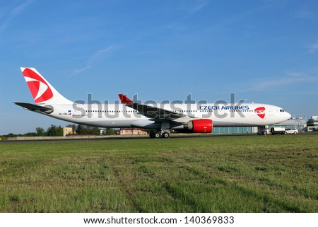 PRAGUE, CZECH REPUBLIC - MAY 15: Czech Airlines Airbus 330-323X stands at PRG Airport on May 15, 2013. Airbus A330 operates flights to Seoul, Moscow and Almaty. - stock photo