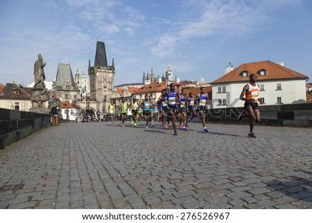 PRAGUE, CZECH REPUBLIC - 3 MAY 2015: Group of runners runs the Volkswagen Prague Marathon, Czech republic. The world's top marathon runners in the lead on Charles Bridge - stock photo