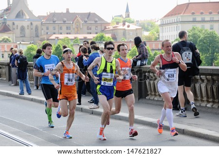 PRAGUE, CZECH REPUBLIC - MAY 12: Group of runners runs the Volkswagen Prague Marathon, May 12, 2013 in Prague, - stock photo