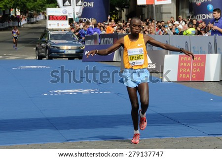 PRAGUE, CZECH REPUBLIC - MAY 3, 2015: Kenyan runner CHEBET KIPLAGAT finishes as the second man the Volkswagen Marathon Prague, May 3, 2015 in Prague, Czech republic. - stock photo