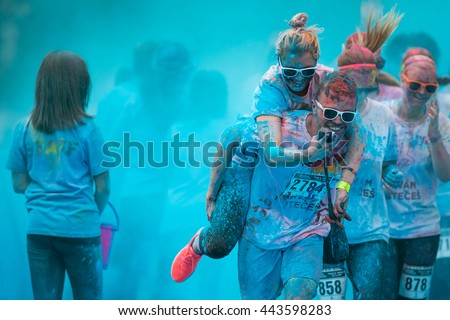Prague, Czech Republic - May 21 2016: People participating in the Color Run. The Color Run is a worldwide hosted 5K fun race - stock photo