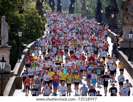 PRAGUE, CZECH REPUBLIC - MAY 13: Runners participate in the Prague International Marathon (PIM), May 13, 2007 in Prague, Czech republic. - stock photo