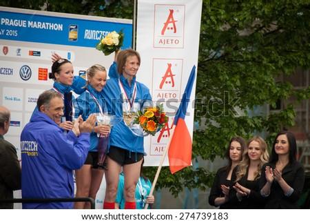 PRAGUE, CZECH REPUBLIC - MAY 3, 2015: Sarka Machackova, Tereza Zuzankova and Radka Churanova - 3 female Czech winners got prizes in the Volkswagen Prague Marathon at the Old Town Square, Prague - stock photo