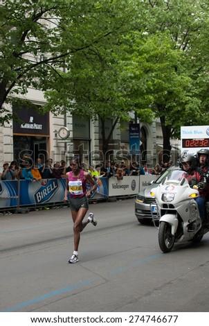 PRAGUE, CZECH REPUBLIC - MAY 3, 2015: Yebrgual Melese, the female winner of  the Volkswagen Prague Marathon 2015 running her last 100 m through Parizska Street to the Old Town Square finish - stock photo