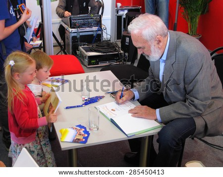 PRAGUE, CZECH REPUBLIC - MAY 15, 2015: Zdenek Sverak signs his new book for children at Book World Prague 2015. Zdenek Sverak won Academy Award (Oscar) for best foreign language film Kolya in 1996. - stock photo
