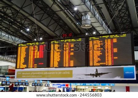 PRAGUE, CZECH REPUBLIC - NOVEMBER 08: Airport departures board in Prague Ruzyne international airport, Czech Republic on November 08, 2014. - stock photo