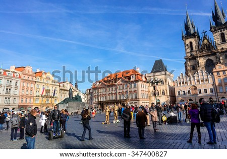 PRAGUE, CZECH REPUBLIC - NOVEMBER 13, 2015: Old Town Square with various architectural styles including the Gothic Church of Our Lady before Tyn, the main church of the city since the 14th century. - stock photo