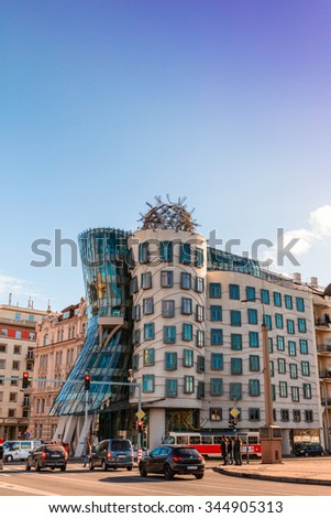 PRAGUE, CZECH REPUBLIC - NOVEMBER 14, 2015: Street view with very non-traditional designed Dancing House on the Rasín Embankment nicknamed as Fred and Ginger House after the famous dancers.  - stock photo