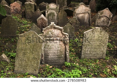 PRAGUE, CZECH REPUBLIC - OCTOBER 15, 2012: Abandoned tombstones at the Old Jewish Cemetery in Prague, Czech Republic. - stock photo