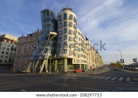 """PRAGUE, CZECH REPUBLIC - OCTOBER 12: Building on October 12, 2008 in Prague: """"Dancing House"""" is a modern building built in 1997 and was designed by architects Frank Gehry and Vlado Milunic. - stock photo"""