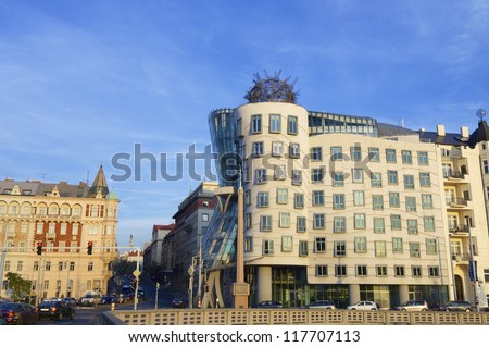 """PRAGUE, CZECH REPUBLIC - OCTOBER 12: Building on October 12, 2008 in Prague: """"Dancing House"""" is a modern building built in 1997 and was designed by architects Frank Gehry and Vlado Milunic - stock photo"""