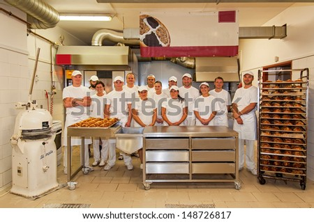 PRAGUE, CZECH REPUBLIC - SEPTEMBER 4, 2012: An unidentified group of bakers team at the working place on September 4, 2012. - stock photo