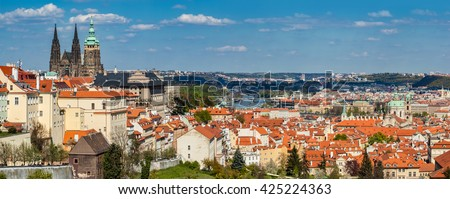Prague, Czech Republic skyline panorama. St. Vitus Cathedral over old town red roofs. - stock photo