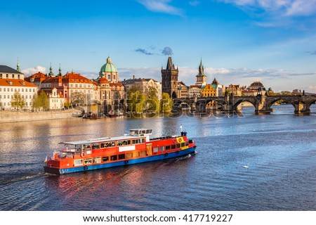 Prague, Czech Republic skyline with historic Charles Bridge. Boat cruise on Vltava river - stock photo