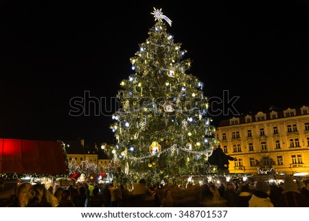 PRAGUE, CZECH REPUBLIC - 6TH DECEMBER 2015: The Christmas Tree at Old Town Square in Prague during the festive season. People can be seen. - stock photo