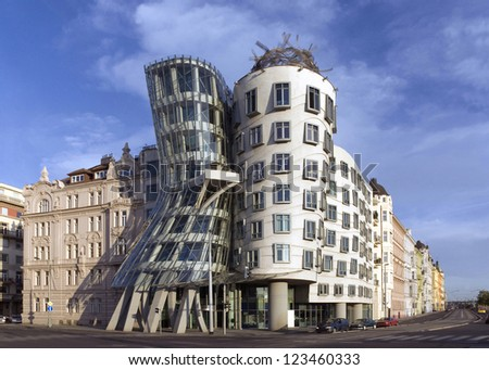 PRAGUE, CZRCH REPUBLIC - JULY 7, 2009: The Dancing House was designed by architects Milunic and Gehry. Modern building stands on Rasin Embankment. Street poles and wires were from picture removed.  - stock photo