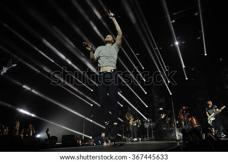PRAGUE - JANUARY 16: Dan Reynolds of US rock band Imagine Dragons performs during a concert at the O2 Arena in Prague, Czech Republic, on January 16, 2016. - stock photo