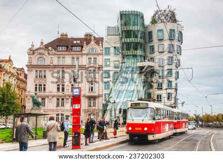PRAGUE - OCTOBER 17:  Nationale-Nederlanden building on October 17, 2014 in Prague, Czech Republic. This building has a nickname The Dancing House or Fred and Ginger. - stock photo