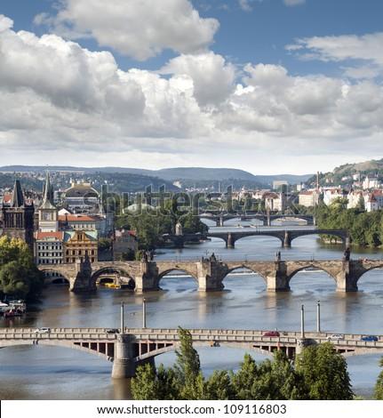 Prague - skyline with Vltava River bridges, Old Town towers, Smichov Quarter and Charles Bridge, Czech Republic  - stock photo