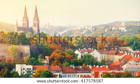 Prague sunset landscape from view to vysehrad church of st peter and paul. Panorama of castle. Autumn cathedral sunset view. - stock photo