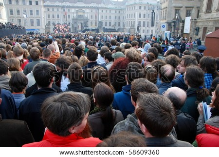 PRAGUE - 4TH APRIL: Crowd of people waiting for the speech of american president Barack Obama in Prague on Prague Castle on April 4, 2009 at Prague Castle, Prague, Czech Republic. - stock photo