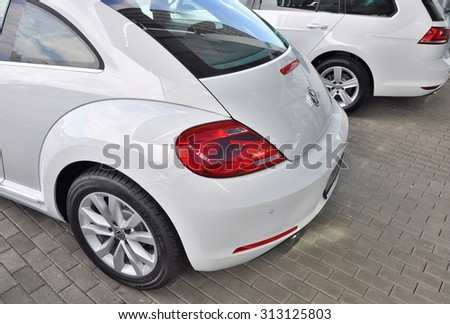 PRAGUE, THE CZECH REPUBLIC, 02.08.2015 - Brand new white Volkswagen Beetle parking in Prague with other VW cars in front of Car Store Volkswagen - stock photo