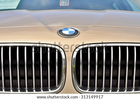 PRAGUE, THE CZECH REPUBLIC, 02.08.2015 - closeup of logo BMW on car in front of Car Store BMW - stock photo