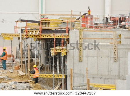 PRAGUE, THE CZECH REPUBLIC, 13.10.2015 - Construction site of big shopping centre in Prague with crane, scaffolding - stock photo