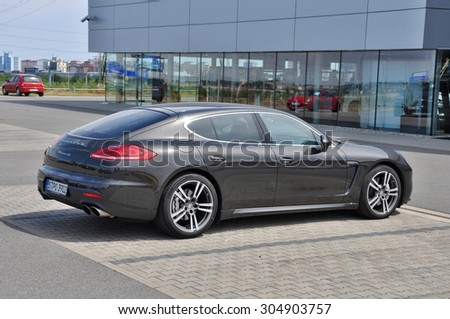 PRAGUE, THE CZECH REPUBLIC, 02.08.2015 - New Porsche Panamera parking in front of car store Porsche Prosek Prague - stock photo