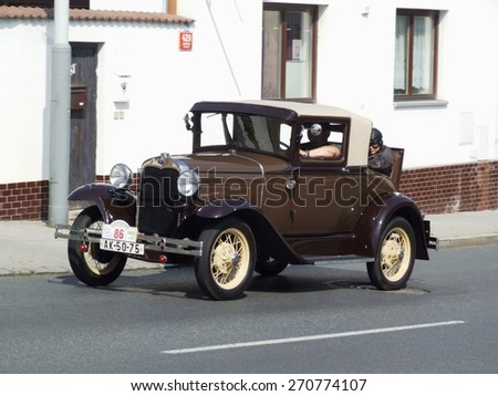 Prague - Zbraslav, Czech Republic - September 06, 2014: Ford - very old American car on the way during veteran race - stock photo