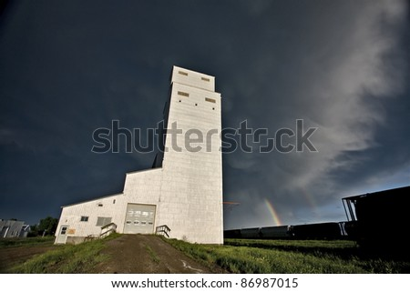 Prairie Grain Elevator in Saskatchewan Canada with storm clouds - stock photo