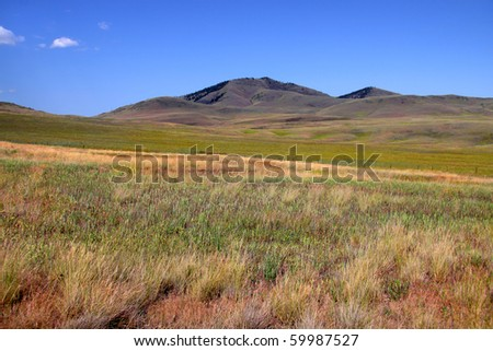Prairie landscape in  north west Montana with blue skies - stock photo