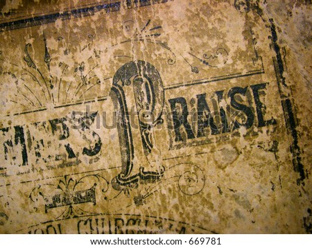 Praise.  Cover of an antique hymnal. - stock photo