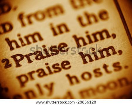 Praise God - macro shot of the Bible text - Psalm 148. - stock photo