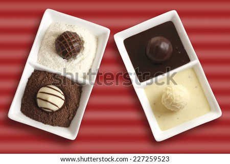 Pralines in chocolate and vanilla sauce, elevated view - stock photo