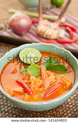 """Prawn and lemon grass soup with mushroom or """"Tom Yum Goong"""" is the most famous of all Thai soups, The Tom Yum Goong both spicy sour taste at all sweet. - stock photo"""