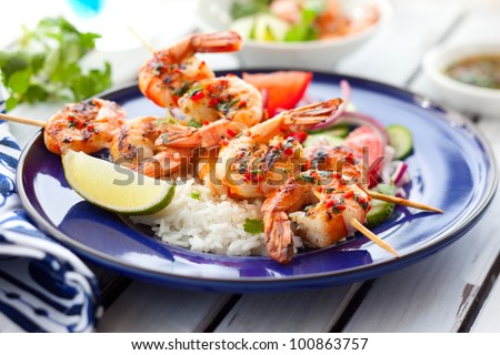 Prawn skewers with rice and vegetable salad - stock photo