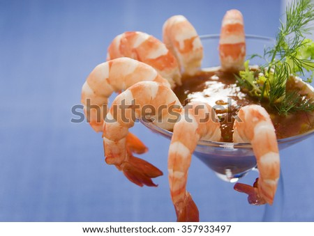 Prawns in a glass with seafood dipping sauce - stock photo