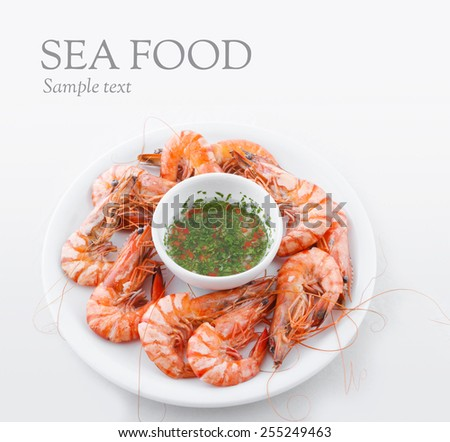 Prawns with fresh spicy salsa  - stock photo