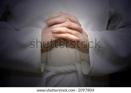 Pray in light - stock photo