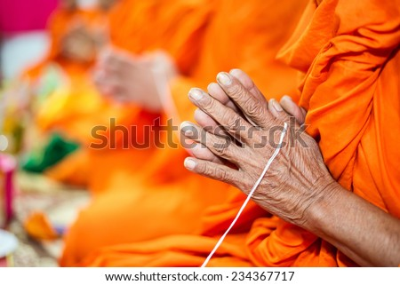 pray, Put the palms of the hands together in salute , monks, thailand - stock photo