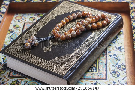 Prayer beads on the Koran. Selective focus - stock photo