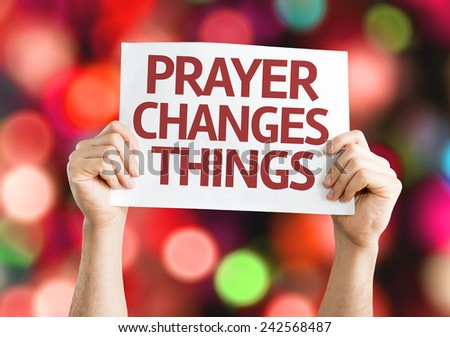 Prayer Changes Things card with colorful background with defocused lights - stock photo