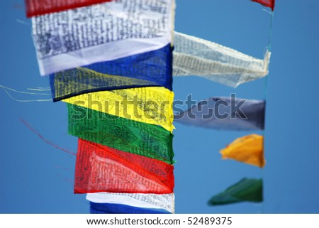 Prayer flags against a background of the blue sky - stock photo