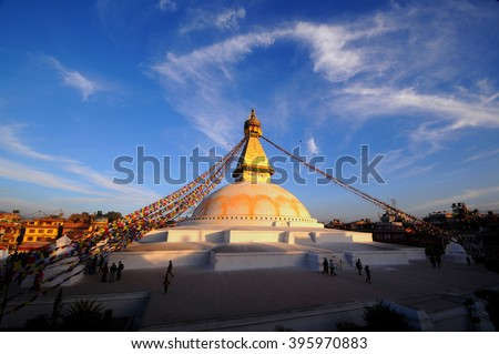 Prayer flags flying on the Boudhanath Stupa. symbol of Kathmandu, Nepal. - stock photo