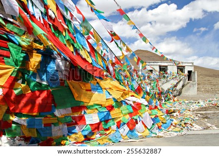 Prayer flags strung across the Friendship Highway in the Himalayan Mountains, Tibet. - stock photo