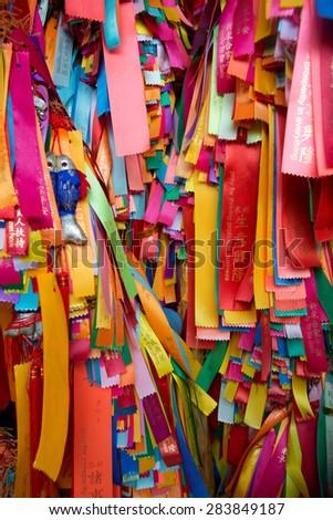 Prayer Ribbons at a temple in Penang, Malaysia - stock photo
