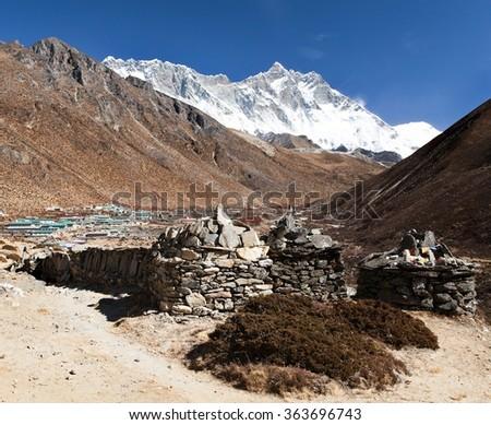 Prayer walls and Dingboche village with mount Lhotse, way to Everest base camp, Khumbu valley, Solukhumbu, Sagarmatha national park, Nepalese himalayas - stock photo